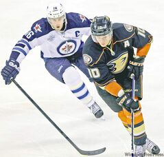 Winnipeg Jets play the Anaheim Ducks at the MTS Centre Saturday night. Winnipeg Jets� Andrew Ladd (16) goes after Anaheim Ducks� Corey Perry (10) in the third period. 111217 - Saturday, December 17, 2011 -  (MIKE DEAL / WINNIPEG FREE PRESS)