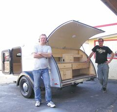 Rick Griffith, left, and Derek Andries,from DJ Cruz's with a Little Guy camper.