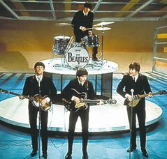 The Beatles perform on the  Ed Sullivan Show on Feb. 9, 1964,  officially kicking off Beatlemania.
