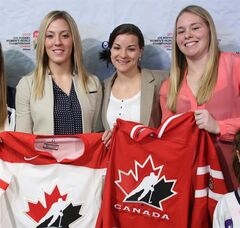 Canada;s National Women's Hockey Team members Meghan Agosta-Marcino, Haley Irwin and Sarah Vaillancourt (left to right) pose after Hockey Canada announced Canada's National Women's Team roster for the upcoming IIHF Ice Hockey Women's World Championship at a news conference in Ottawa, Monday, March 18 2013. THE CANADIAN PRESS/Fred Chartrand