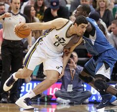 Utah Jazz's Enes Kanter (0) drives against Minnesota Timberwolves' Gorgui Dieng (5) in the second quarter of an NBA basketball game Saturday Feb. 22, 2014, in Salt Lake City. (AP Photo/Rick Bowmer)