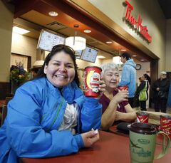 Andrea Gerard (left) and Eileen Meade enjoy a coffee at the Sagkeeng  Tim Hortons.
