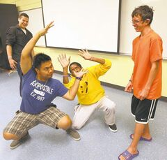 Dustin Thompson (from left), Christopher Bryan, Frank Nausigimana and Cody Remillard try out their mime chops.