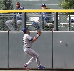 Los Angeles Dodgers center fielder Andre Ethier attempts to catch the triple hit by Colorado Rockies' Brandon Barnes to drive in the winning run in the 10th inning of the Rockies' 5-4 victory in 10 innings in a baseball game in Denver on Saturday, June 7, 2014. (AP Photo/David Zalubowski)