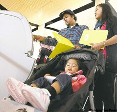 John and Cheryl Acosta with their daughter, Leanna, 1. (TREVOR HAGAN/WINNIPEG FREE PRESS)