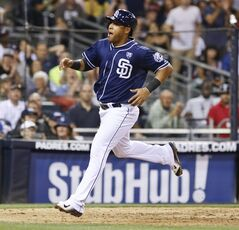 San Diego Padres' Yangervis Solarte reacts to scoring on a wild pitch in the seventh inning against the Atlanta Braves of a baseball game Saturday, Aug. 2, 2014, in San Diego. (AP Photo/Don Boomer)