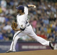 Milwaukee Brewers starting pitcher Yovani Gallardo throws to the Cincinnati Reds during the first inning of a baseball game Saturday, June 14, 2014, in Milwaukee. (AP Photo/Jeffrey Phelps)