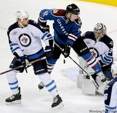 Jets goalie Ondrej Pavelec and blue-liner Zach Bogosian (left) were too much for Gabriel Landeskog and the Avs during Tuesday night's 4-1 Winnipeg win.