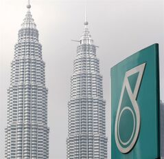 A Petronas logo is seen near its twin towers in Kuala Lumpur, Malaysia, on July 1, 2010. THE CANADIAN PRESS/AP, Lai Seng Sin