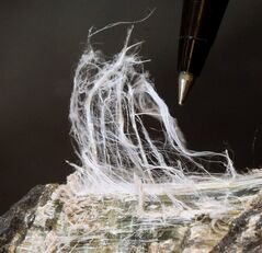 Asbestos fibers found inside a serpentine rock is pictured in Modesto, Calif., Wednesday, July 14, 2010. THE CANADIAN PRESS/AP, Rich Pedroncelli