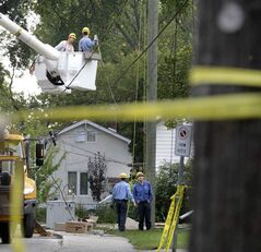 Hydro crews work on pole this morning.