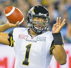 Hamilton Tiger-Cats quarterback Henry Burris throws the ball against the Toronto Argonauts during first half CFL Eastern Conference final football action in Toronto on Sunday, Nov. 17, 2013. THE CANADIAN PRESS/Nathan Denette