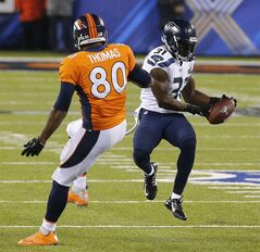 Seattle Seahawks strong safety Kam Chancellor (31) intercepts a pass intended for Denver Broncos tight end Julius Thomas (80) during the first half of the NFL Super Bowl XLVIII football game Sunday, Feb. 2, 2014, in East Rutherford, N.J. (AP Photo/Matt York)