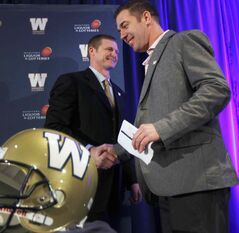 Winnipeg Blue Bombers new head coach Mike O'Shea is introduced by GM Kyle Walters at a news conference at the Fairmont Hotel in downtown Winnipeg Wednesday.
