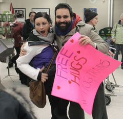 Arié  Moyal surprises German traveller Anne Maeder with a quick hug at Union Station Monday morning.