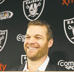 Oakland Raiders new quarterback Matt Flynn smiles during a news conference at the team's NFL football headquarters in Alameda, Calif., Tuesday, April 2, 2013. The Raiders acquired Flynn from the Seattle Seahawks on Monday, for a fifth-round pick in 2014 and a conditional pick in 2015. (AP Photo/Jeff Chiu)