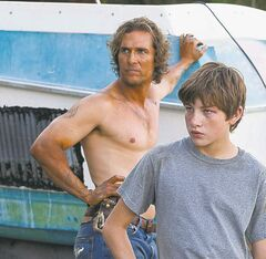 This film image released by Roadside Attractions shows Matthew McConaughey, left, and Tye Sheridan in a scene from