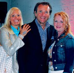 Vintage Bling owner Dayle Goertzen (right) is shown with Canadian businessman and Dragons' Den star Robert Herjavec and his wife Diane Plese at the Toronto International Film Festival in September. Goertzen, an East St. Paul resident, had a gifting suite where she presented homemade bracelets to celebrities for four days of the festival.