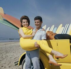 FILE - In this 1963 file photo, singer Frankie Avalon and actress Annette Funicello are seen on Malibu Beach during filming of