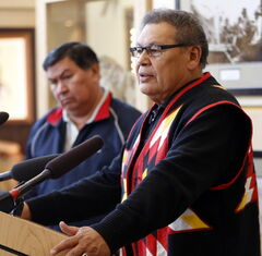 Chief Jim Bear (right), hockey organizer Garry Houle announce penalties.