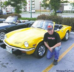 Peter Foreman with his Inca yellow Triumph Spitfire.