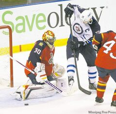 Panthers goalie Scott Clemmensen denies Jets captain Andrew Ladd on Friday night at Bank Atlantic Center in Sunrise, Fla.