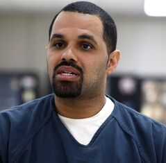 In this May 7, 2014 photo, Rene Lima-Marin sits for an interview with The Associated Press about the circumstances of his sentencing and incarceration, in a meeting room inside Kit Carson Correctional Center, a privately operated prison in Burlington, Colo. Lima-Marin, who was sent back to prison after being mistakenly released 90 years early, says it was cruel and unusual punishment to put him back behind bars after he reformed his life. An appeal filed Wednesday, Aug. 20, 2014 in his case also says his constitutional rights were violated when a judge in January ordered him to finish his sentence after he started a family during nearly six years of freedom. A judge in 2000 sentenced Lima-Marin to a total of 98 years in prison for multiple counts stemming from the robbery of two video stores when Lima-Marin was 20. (AP Photo/Brennan Linsley)