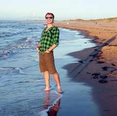 Travel blogger Corbin Fraser on the shores of Prince Edward Island.