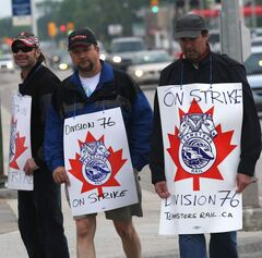 CP workers walk the picket line on McPhillips Street this morning.
