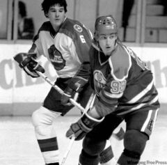 KEN GIGLIOTTI / WINNIPEG FREE PRESS ARCHIVES  Those were the days: Barry Legge tries to check a young centreman from Edmonton.