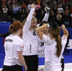 From left: Dawn McEwen, Jennifer Jones, Jill Officer and Kaitlyn Lawes celebrate after defeating Sherry Middaugh 8-4 in the women's final of Roar of the Rings Olympic curling trials at the MTS Centre Saturday night.