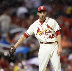 St. Louis Cardinals' Kevin Siegrist ooks down after giving up a grand slam to San Diego Padres' Jedd Gyorko in the seventh inning in a baseball game, Saturday, Aug. 16, 2014, at Busch Stadium in St. Louis. The Padres won 9-5. (AP Photo/Bill Boyce)