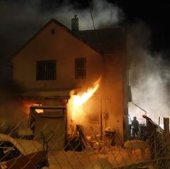 Winnipeg Fire Fighters battled a house fire on Grove Street Friday morning.
