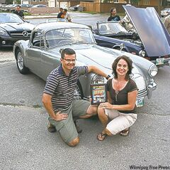Dennis and Sandra Watson with their 1959 MGA Coupe. The couple's rare ride is a finalist for the coveted Cruise Night Challenge award.