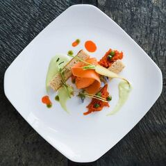 In this undated photo shows the Peas & Carrots dish at Kelly Liken in Vail, Colo. Among the desserts Kelly Liken and pastry chef Colleen Carey have come up with are Peas & Carrots, a concoction that includes brown butter financier, with a sauce of English peas alongside carrot sorbet and carrot marmalade. (AP Photo/The Vail Daily, Anthony Thornton)