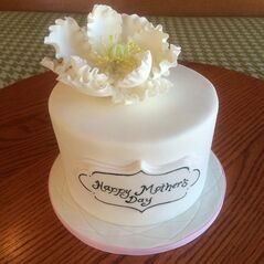 This undated photo provided by Tiffany Jones and posted in May 2014 to the Instagram account of her company, Peridot Sweets Las Vegas, shows a Mother's Day cake. Jones says she sold seven of the cakes to people who saw the photo on Instagram. The photo also automatically posted to the company's Facebook page, which is followed by nearly 1,200. She sold six more cakes to Facebook fans. (AP Photo/Courtesy Tiffany Jones)
