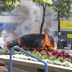 A witness said an eastbound van hit the median on Portage Avenue near Carlton Street and burst into flames.