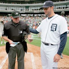 Detroit pitcher Armando Galarraga consoles tearful home plate umpire Jim Joyce prior to the start of the Tigers game against the Cleveland Indians Thursday.