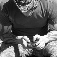Mast.-Cpl. Nick West texts on a break.