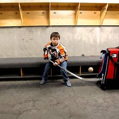 Daimon Gardner, 9, has some fun in the dressing room before his game in Warroad, Minn.