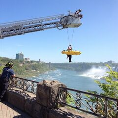 In this photo provided by Jared Fisk, Niagara Falls emergency officials rescue a man who plunged over Niagara Falls and survived in an apparent suicide attempt, Monday, May 21, 2012. THE CANADIAN PRESS/AP, Jared Fisk