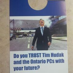 A flyer depicting Ont. PC leader Tim Hudak laughing as he walks away from an exploding hospital is shown. THE CANADIAN PRESS/HO