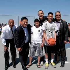 (Left to right) École Stanley Knowles School principal Darryl Stevenson, Point Douglas city councillor Mike Pagtakhan, Winnipeg Blizzards head coach Ruel Maranan, Minister of Children and Youth Opportunities Kevin Chief, Stanley Knowles basketball player Shawn Maranan and Tyndall Park MLA Ted Marcelino.