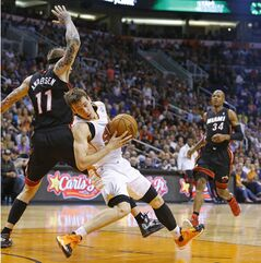 Phoenix Suns guard Goran Dragic (1) is fouled by Miami Heat forward Chris Andersen (11) during the first half of an NBA basketball game Tuesday, Feb. 11, 2014, in Phoenix. (AP Photo/The Arizona Republic, David Kadlubowski) MAGS OUT NO SALES MESA OUT MARICOPA COUNTY OUT