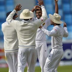 Sri Lanka bowler Suranga Lakmal, center, celebrates his wicket together with team members during the second cricket test match between Pakistan and Sri Lanka, at the Dubai International Cricket Stadium in Dubai, United Arab Emirates, Wednesday, Jan. 8 2014. (AP Photo/Ineke Zondag)