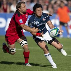 Team Canada, left, tries to regain control of the ball from team Japan during their international rugby match at Swangard Stadium in Burnaby, B.C., Saturday, June, 7, 2014. THE CANADIAN PRESS/Jonathan Hayward