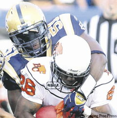 Barrin Simpson taking down B.C. Lions Stefan Logan earlier this year.