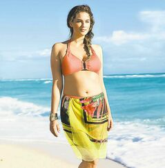 Plus-size model Jennie Runk, who is a size 12 or 14, in an H&M swimsuit ad.