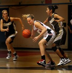 Winnipeg Wesmen's Stephanie Kleyson (4) battles for possession against Manitoba Bisons' Sheree Carmona-Galdamez (5) Wednesday night.