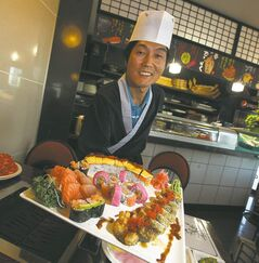 Hiroba chef Seok-Soon Hong shows off a platter of colourful sushi and sashimi.